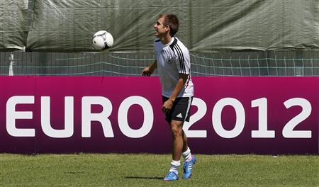 Germany's national soccer player Philipp Lahm warms-up during a training session in Gdansk, June 19, 2012, ahead of their Euro 2012 match against Greece on June 22. REUTERS/Thomas Bohlen