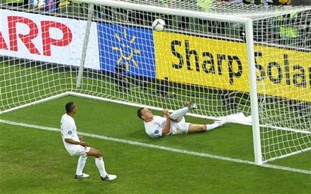 England's Ashley Cole (L) watches as England's John Terry (R) clears the ball from the goal mouth during their Group D Euro 2012 soccer match at the Donbass Arena in Donetsk, June 19, 2012. REUTERS/Felix Ordonez