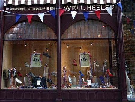 Posters depicting Britain's Queen Elizabeth are seen in the window of a shoe shop on Knightsbridge road in west London May 27, 2012. REUTERS/Marika Kochiashvili
