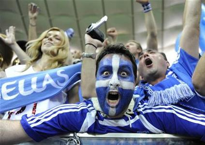 Greece's soccer fans celebrate victory against Russia after their Group A Euro 2012 soccer match at the National stadium in Warsaw, June 16, 2012. REUTERS/Pawel Ulatowski