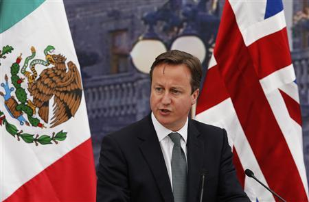 Britain's Prime Minister David Cameron delivers a speech during a dinner with Mexico's President Felipe Calderon at Chapultepec Castle in Mexico City June 20, 2012. REUTERS/Bernardo Montoya