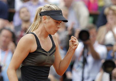 Maria Sharapova of Russia reacts during her women's singles final match against Sara Errani of Italy at the French Open tennis tournament at the Roland Garros stadium in Paris June 9, 2012. REUTERS/Gonzalo Fuentes