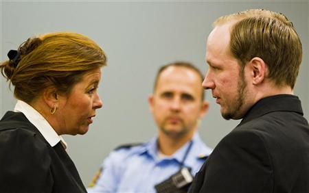 Mass murderer Anders Behring Breivik (R) speaks to one of his lawyers Vibeke Hein Baera, in court in Oslo June 18, 2012. REUTERS/Vegard Groett/NTB Scanpix/Pool