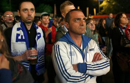 Greece soccer supporters react after Germany scored during the Euro 2012 soccer match between Germany and Greece, at the fan zone in Gdansk, June 22, 2012. REUTERS/Kacper Pempel