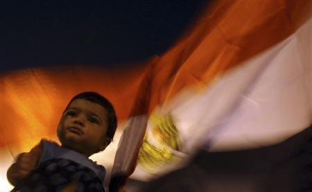 A baby of a supporter of former prime minister and current presidential candidate Ahmed Shafik is seen during a protest against the Muslim Brotherhood's presidential candidate Mohamed Morsy as they cheer for the Supreme Council for the Armed Forces (SCAF) at Nasr City in Cairo June 23, 2012. REUTERS/Amr Abdallah Dalsh