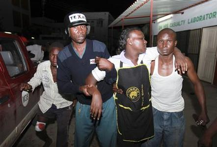 A bar attendant injured in a blast at Jerico Pub in the Kenyan Coast arrives for treatment at the Coast General Hospital in Mombasa June 24, 2012. REUTERS/Joseph Okanga