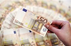 <p>Selon la presse locale, Chypre, devenu le cinquième pays de la zone euro à se faire appel à une aide financière de l'Union européenne, pourrait avoir besoin d'une somme représentant plus de la moitié de son produit intérieur brut (PIB). Le montant total de l'aide, que Nicosie définira dans les semaines à venir, pourrait être compris entre six et 10 milliards d'euros. /Photo d'archives/REUTERS/Dado Ruvic</p>