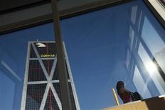 <p>Les banques espagnoles, sous l'effet de l'aide publique que va leur octroyer l'Europe, vont être amenées à céder une montagne d'actifs de grandes entreprises, ce qui rebattra les cartes de l'actionnariat de bon nombre de sociétés de premier plan en Espagne. /Photo prise le 25 juin 2012/REUTERS/Susana Vera</p>