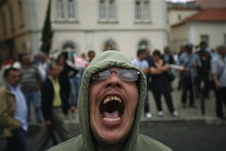 A demonstrator shouts slogans against the government during a protest opposite the Portuguese parliament in Lisbon, in this June 6, 2012 file photo. REUTERS/Rafael Marchante/Files