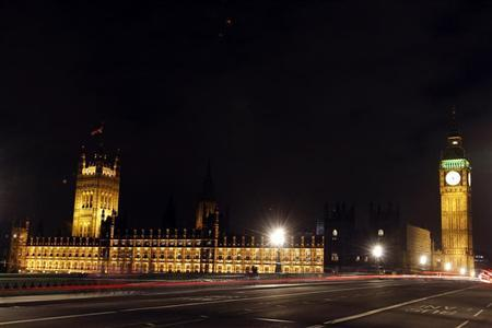 Light trails made by cars driving over Westminster Bridge, are seen in front of Britain's Houses of Parliament in London January 18, 2011. Members of the House of Lords resumed an all-night debate Tuesday, on changes to the British voting system. REUTERS/Stefan Wermuth