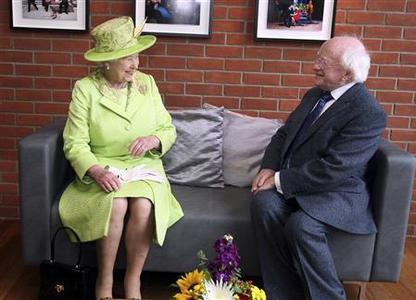 Britain's Queen Elizabeth meets Ireland's President Michael D. Higgins during a visit to the Lyric Theatre in Belfast June 27, 2012. REUTERS/Paul Faith/POOL