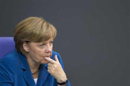 German Chancellor Angela Merkel gestures after she delivers a government policy statement at the lower house of parliament, the Bundestag, in Berlin June 27, 2012. REUTERS/Thomas Peter