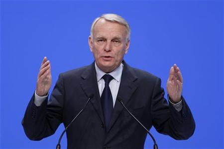 France's Prime Minister Jean-Marc Ayrault delivers a speech as he attends a political rally for the upcoming second tour of the legislative elections in Paris June 13, 2012. REUTERS/Gonzalo Fuentes