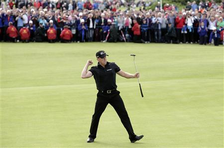 Jamie Donaldson of Wales celebrates winning the Irish Open at Royal Portrush, Northern Ireland July 1, 2012. REUTERS/Cathal McNaughton