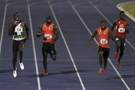 Usain Bolt (L) and Yohan Blake (2nd R) run during the men's 200 meters final at the Jamaican Olympic trials in Kingston city July 1, 2012. REUTERS/Ivan Alvarado