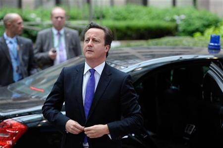 Britain's Prime Minister David Cameron arrives on the second day of a European Union leaders summit in Brussels June 29, 2012. REUTERS/Eric Vidal