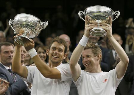 REFILE - CORRECTING BYLINE Jonathan Marray of Britain (R) and his partner Frederik Nielsen of Denmark hold their trophies after defeating Robert Lindstedt of Sweden and Horia Tecau of Romania in their men's doubles tennis match at the Wimbledon tennis championships in London July 7, 2012. REUTERS/Stefan Wermuth