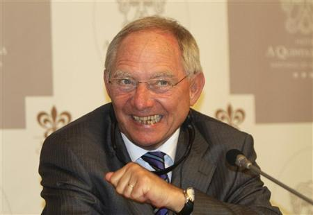 Germany's Finance Minister Wolfgang Schaeuble smiles during a news conference before a seminar organized by the Konrad Adenauer Foundation, linked to Germany's Chancellor Angela Merkel's Christian Democrats (CDU), in Santiago de Compostela April 30, 2012. REUTERS/Miguel Vidal