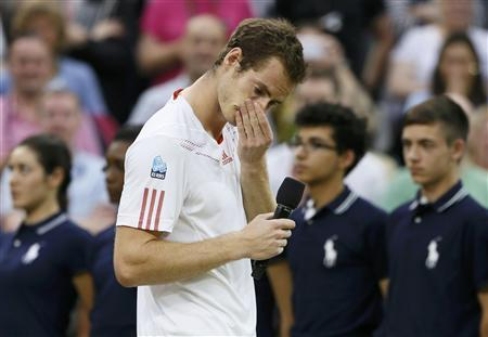 Andy Murray of Britain reacts during a television interview with Sue Barker after being defeated by Roger Federer of Switzerland in their men's singles final tennis match at the Wimbledon Tennis Championships in London July 8, 2012. REUTERS/Stefan Wermuth