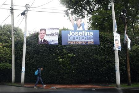 A man walks outside the headquarters of Josefina Vazquez Mota, presidential candidate of the ruling National Action Party (PAN), in Mexico City June 30, 2012. REUTERS/Tomas Bravo