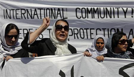 Women march with banners to protest the recent public execution of a young woman, in Kabul July 11, 2012. The Taliban denied involvement in the killing in Parwan province, in which an unnamed woman's head and body were riddled with bullets at close range in punishment for alleged adultery. Authorities in Kabul directly blamed the Islamist group. REUTERS/Omar Sobhani