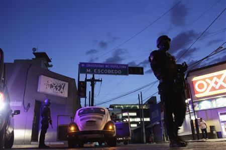 Police patrol near the main office of the newspaper El Norte in Monterrey July 10, 2012. REUTERS/Daniel Becerril