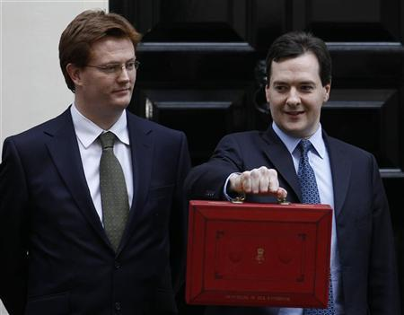 Britain's Chief Secretary to the Treasury Danny Alexander (L) looks on as Britain's Chancellor of the Exchequer George Osborne holds the traditional red briefcase as he leaves for the Houses of Parliament from his official residence in Downing Street in central London March 21, 2012. REUTERS/Suzanne Plunkett