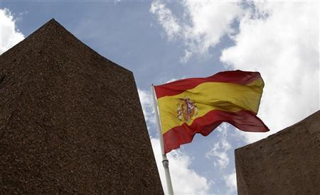 A Spanish flag flutters in the wind in central Madrid June 11, 2012. REUTERS/Andrea Comas