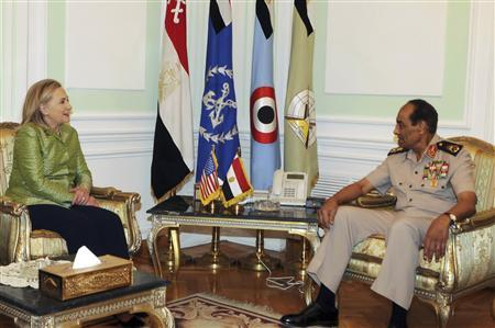 Egyptian military chief Field Marshal Mohamed Hussein Tantawi (R) meets with U.S. Secretary of State Hillary Clinton at the Defence Ministry in Cairo July 15, 2012. Hundreds of people chanted anti-U.S. and anti-Islamist slogans outside Hillary Clinton's hotel on Saturday as the U.S. secretary of state urged Egypt's military and Muslim Brotherhood to complete a transition to full democratic rule. REUTERS/U.S Embassy Media Office/Handout