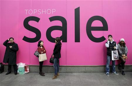 Shoppers waits outside a store during the annual Boxing Day sales on Oxford Street in London December 26, 2011. REUTERS/Stefan Wermuth