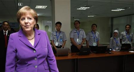 German Chancellor Angela Merkel visits the tsunami early warning center of Indonesia's Meteorology and Geophysics Agency in Jakarta July 11, 2012. REUTERS/Supri