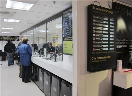 People make use of the exchange bureau at the Marks and Spencer flagship store in London June 8, 2012. REUTERS/Paul Hackett
