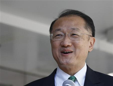 Jim Yong Kim, the new President of the World Bank Group, speaks to the press as he arrives for his first day on the job at the World Bank Headquarters in Washington, July 2, 2012. REUTERS/Jason Reed