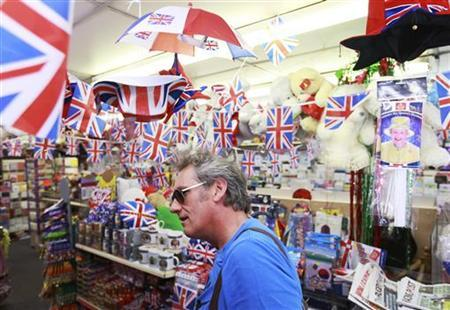 A shopper browses jubilee decorations for sale in a newsagents in Stoke Newington, east London, May 29, 2012. REUTERS/Olivia Harris