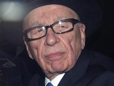 News Corporation Chief Executive and Chairman Rupert Murdoch leaves after giving evidence at the Leveson Inquiry at the High Court in London in this April 26, 2012 file photo. REUTERS/Olivia Harris/Files