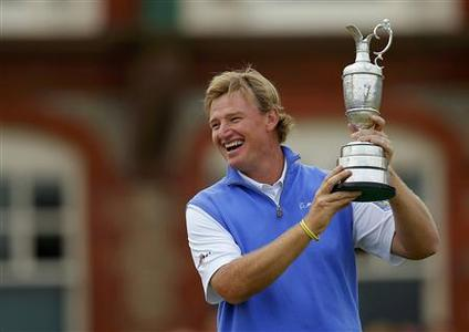 Ernie Els of South Africa holds up the Claret Jug after winning the British Open golf championship at Royal Lytham & St Annes, northern England July 22, 2012. REUTERS/Brian Snyder