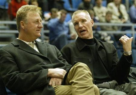 NBA legends Larry Bird (L) and Chris Mullin (R) chat while scouting for talent during Good Year League basketball match Partizan-Zagreb in Belgrade January 15, 2005. REUTERS/Ivan Milutinovic
