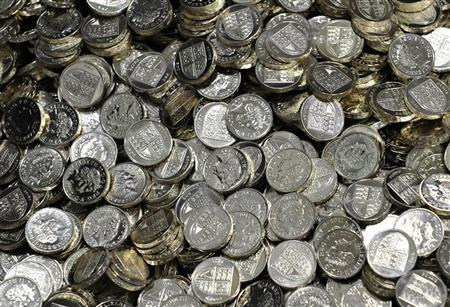 Newly minted one pound coins are seen at the Royal Mint, in Cardiff March 5, 2011. REUTERS/Toby Melville