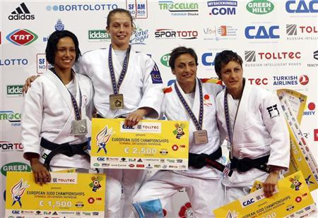 Gold medallist France's Penelope Bonna (2nd L) poses with silver medallist Portugal's Joana Ramos (L), bronze medallists Britain's Sophie Cox (R) and Spain's Ana Carrascosa (2nd R) during a ceremony for the women's under 52 kg category at the Judo European Championships in Istanbul April 21, 2011. REUTERS/Osman Orsal