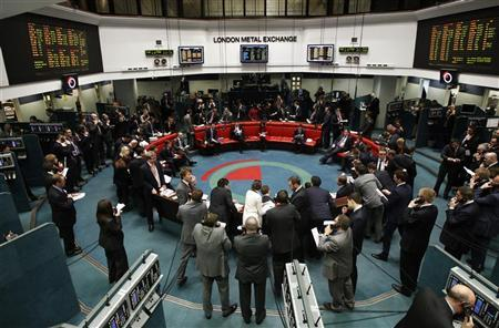 Traders and clerks react on the floor of the London Metal Exchange in the City of London February 14, 2012. The London Metal Exchange has several serious potential bidders and will consider takeover proposals at its board meeting in late February, Chief Executive Martin Abbott said. REUTERS/Luke MacGregor