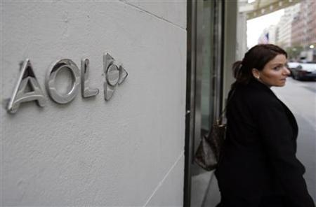 A woman walks out of AOL offices in New York, November 19, 2009. REUTERS/Shannon Stapleton