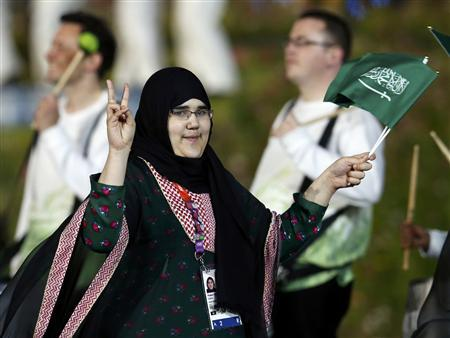 Saudi Arabia's Wojdan Ali Seraj Abdulrahim Shaherkani gestures as she walks with the contingent in the atheletes parade during the opening ceremony of the London 2012 Olympic Games at the Olympic Stadium July 27, 2012. REUTERS/Suzanne Plunkett