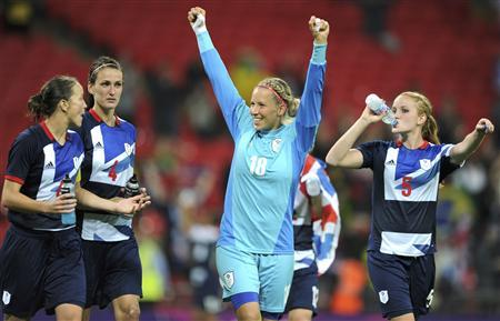British goalie Karen Bardsley (C) celebrates defeating Brazil in their women's Group E football match at the London 2012 Olympic Games at Wembley stadium in London July 31, 2012. REUTERS/Paul Hackett