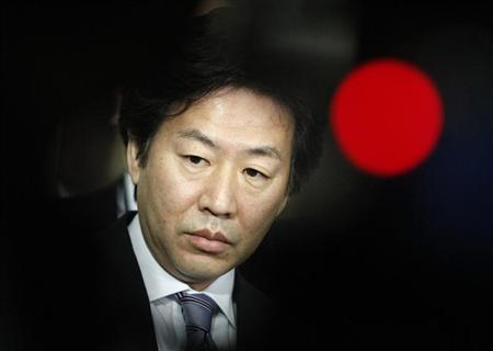 Japan's Finance Minister Jun Azumi is seen between television cameras as he speaks to members of the media after a meeting with Jim Yong Kim, the U.S. nominee for the next World Bank president, at the Finance Ministry in Tokyo April 1, 2012. REUTERS/Issei Kato