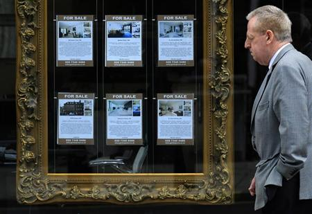 A man passes an estate agent's window in London Septermber 27, 2010. REUTERS/Luke MacGregor
