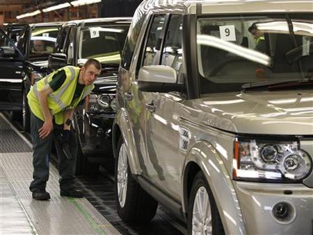 A worker inspects a Land Rover Discovery on the production line at their factory in Solihull, central England, February 28, 2012. Land Rover's one millionth Discovery comes off the production line on Wednesday. Picture taken February 28, 2012. REUTERS/Darren Staples