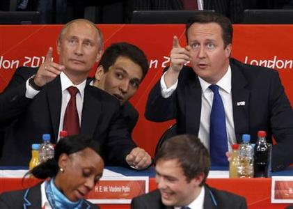 Russian President Vladimir Putin (background L) and Britain's Prime Minister David Cameron (background R) point as they watch the women's -78kg and men's 100kg judo competition at the London 2012 Olympic Games August 2, 2012. REUTERS/Luke Macgregor