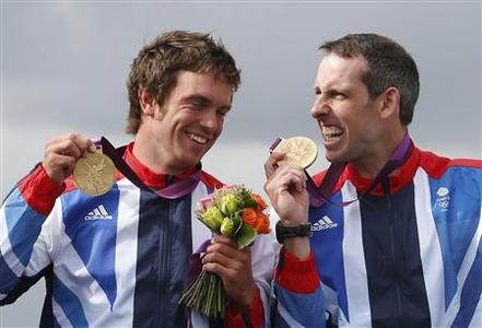 Gold medallists Britain's Tim Baillie (L) and Etienne Stott celebrate on the podium during the victory ceremony for the men's canoe double (C2) final at Lee Valley White Water Centre during the London 2012 Olympic Games August 2, 2012. REUTERS/Suzanne Plunkett
