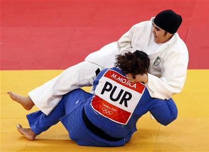 Saudi Arabia's Wojdan Shaherkani (top) fights with Puerto Rico's Melissa Mojica during their women's +78kg elimination round of 32 judo matchat the London 2012 Olympic Games August 3, 2012. REUTERS/Darren Staples