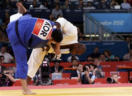 France's Teddy Riner (white) fights with South Korea's Kim Sung-min during their men's +100kg semifinal judo match at the London 2012 Olympic Games August 3, 2012. REUTERS/Toru Hanai